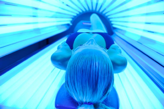woman in a tanning booth