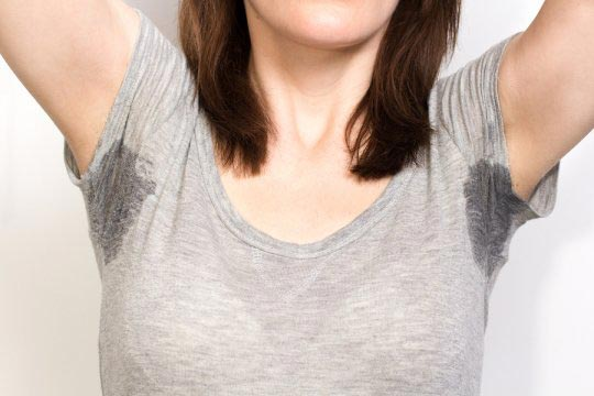woman with sweat stains under arms